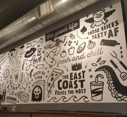 The wall at Tony Boloney's Pizza in Hoboken, NJ