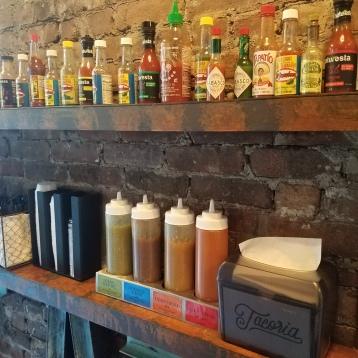 Wall of hot sauces at Tacoria - Jersey City, NJ